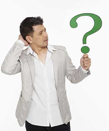 Man holding up a question mark symbol